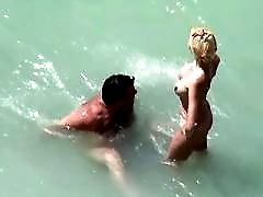 Sexy blondie and her affy guy having sex on a beach