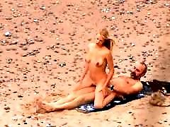 Sexcited mature chick gets some action on a beach
