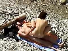 Cute chick with sweet tits shot on a nude beach