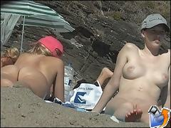 Two nude hotties are under control of beach spy cams